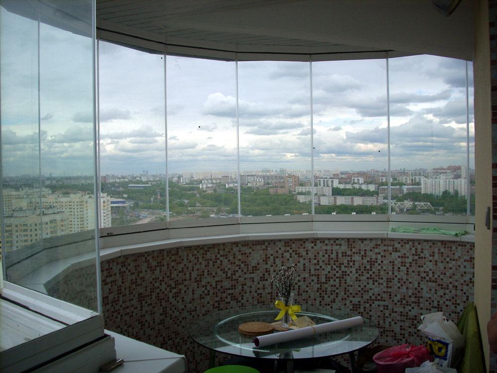 """Безрамное остекление балконов и лоджий в спб - """"окна империа."""