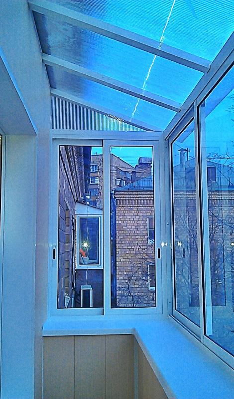 Застеклить балкон с крышей.